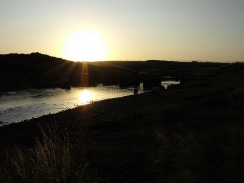 Colour photograph of sunrise at the Bush foot, Co Antrim, Northern Ireland
